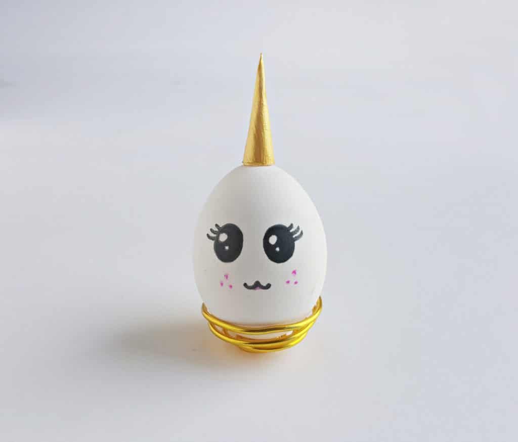 unicorn egg with unicorn horn in gold