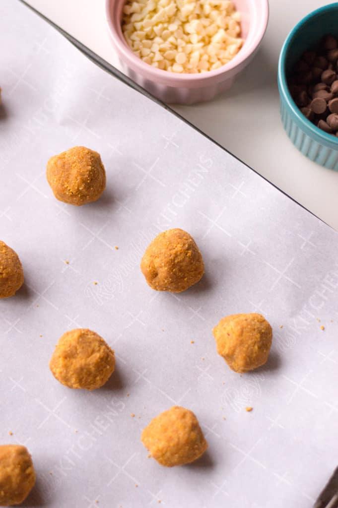 peanut butter truffles on parchment paper