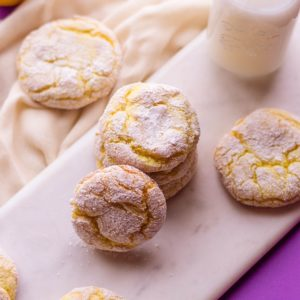 lemon crinkle cookies with a glass of milk