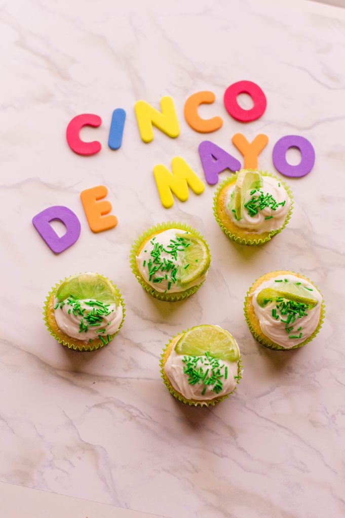margarita cupcakes next to letter shapes for cinco de mayo