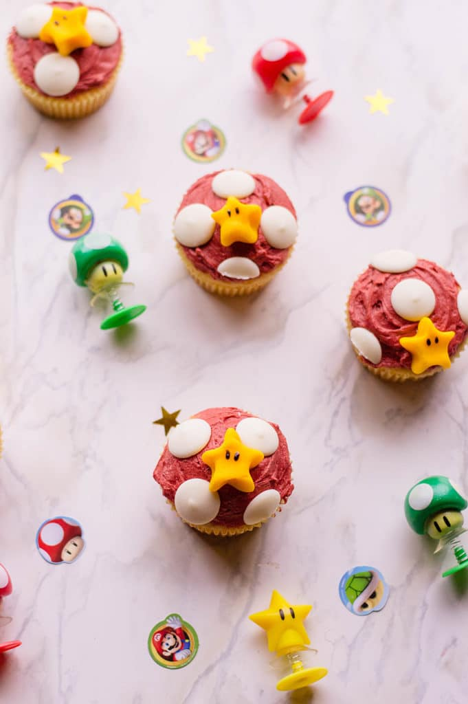 super mario cupcakes on a marble surface and nintendo props