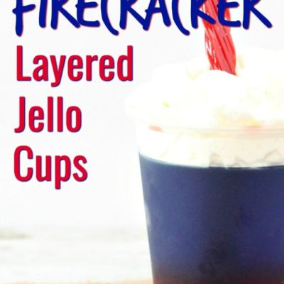 layered jello cups with a twizzler sticking out of whipped cream