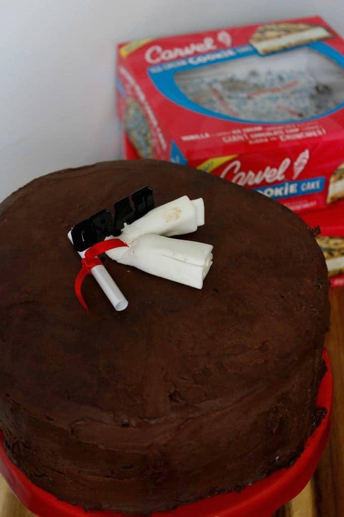 graduation cake with chocolate ganache coating