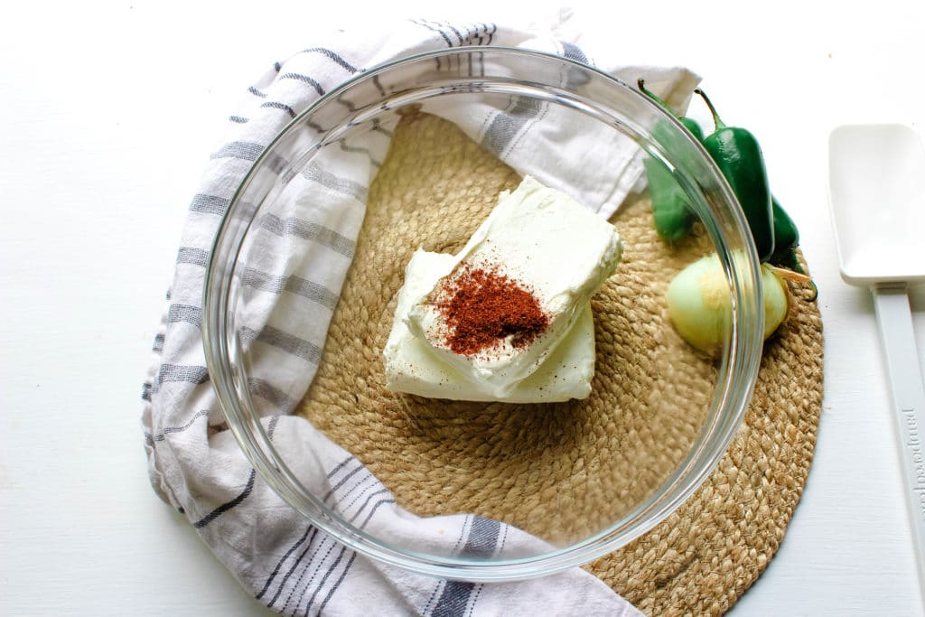 cream cheese, jalapenos and seasoning in a bowl