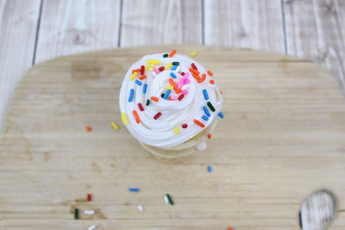 top of ice cream cone cupcake topped with rainbow sprinkles
