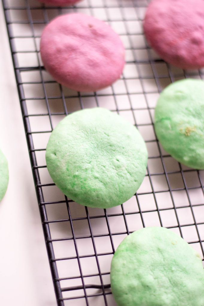 green and pink whoopies pies cooling on rack