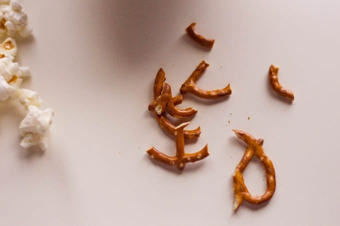 broken pieces of pretzels to be used in sweet and salty popcorn