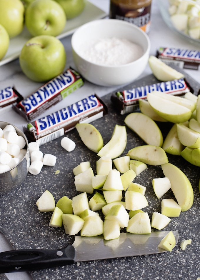 Chop the apples into chunks.