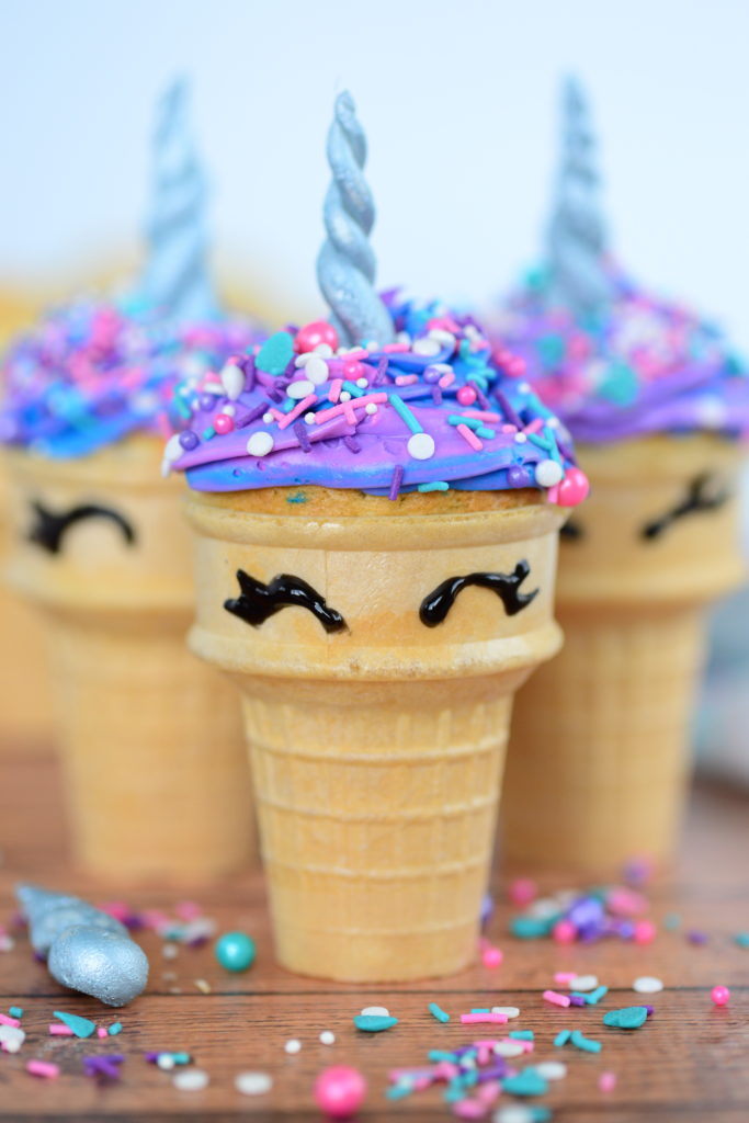close up shot of unicorn cupcakes in ice cream cones