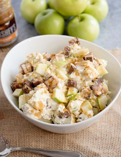This caramel apple Snickers is a fun fall recipe will get your kids to really rethink their definition of what a salad is! Perfect for potlucks and entertaining, this autumn treat is a family favorite and so, so easy. #salad #snickers #caramel #apple #kidfriendly