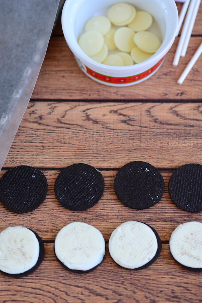 Separate the Oreo halves.