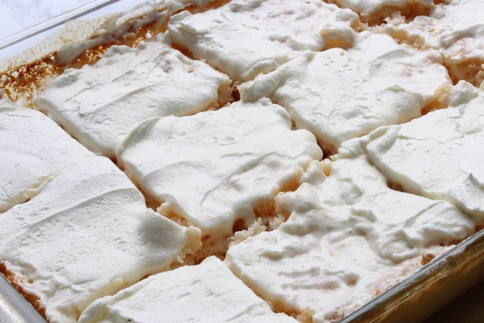 This cake, especially with the Cool Whip topping, is awesome served with cool pineapple or cherries on top . It gives that nice burst of freshness with every bite!