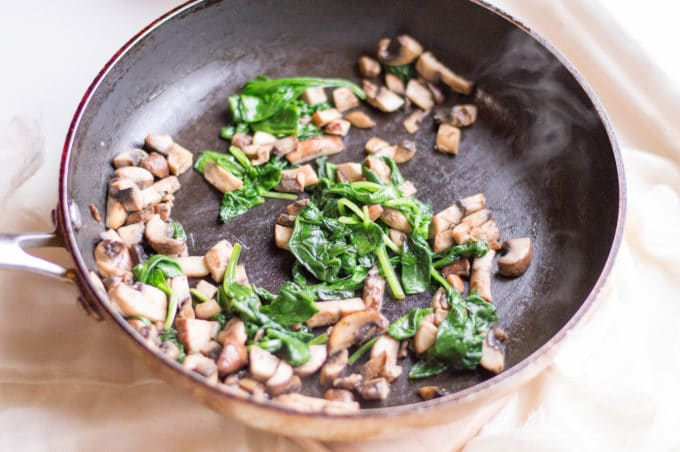 On a pan over medium heat, melt butter then cook mushrooms until they sweat. Add spinach until completely cooked. Remove from heat.
