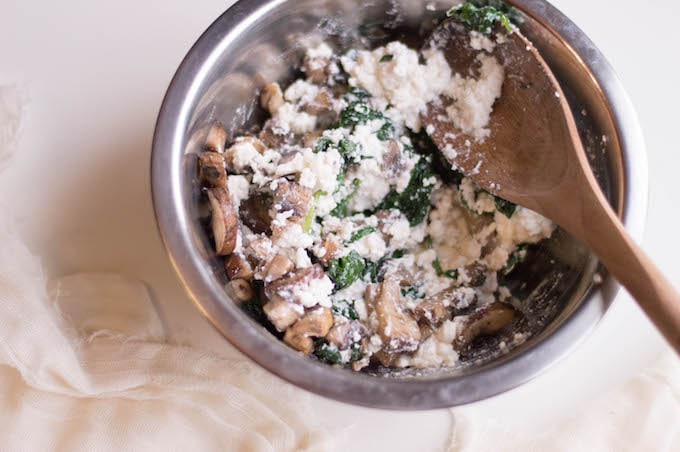 Add ricotta cheese into a medium-sized bowl and fold in your mushrooms and spinach.