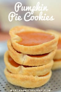 pumpkin pie cookies stacked on baking sheet
