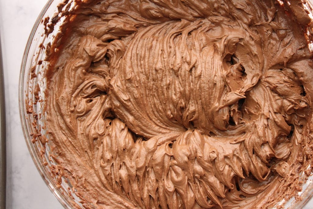 overhead shot of chocolate fudge icing in bowl
