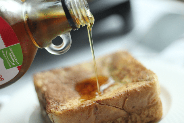 pouring syrup over cinnamon french toast