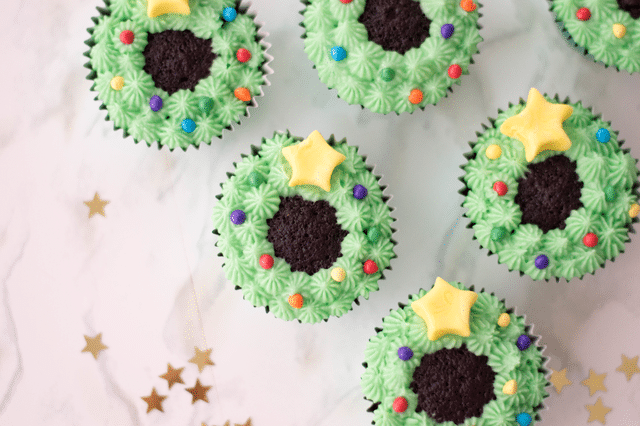 cupcakes with green icing, yellow stars