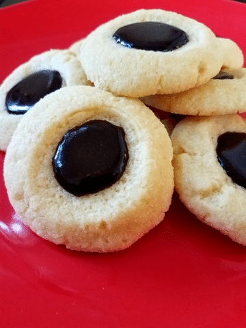 thumbprint cookies on a red plate