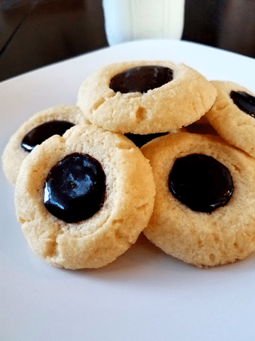 thumbprint cookies on a white plate