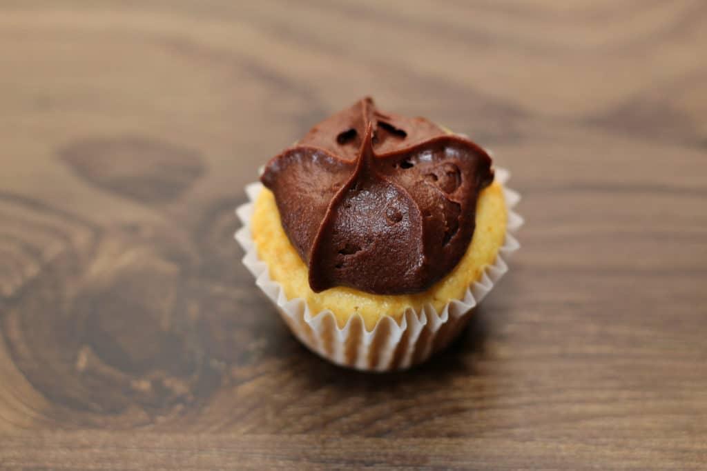 chocolate dollop on vanilla cupcake