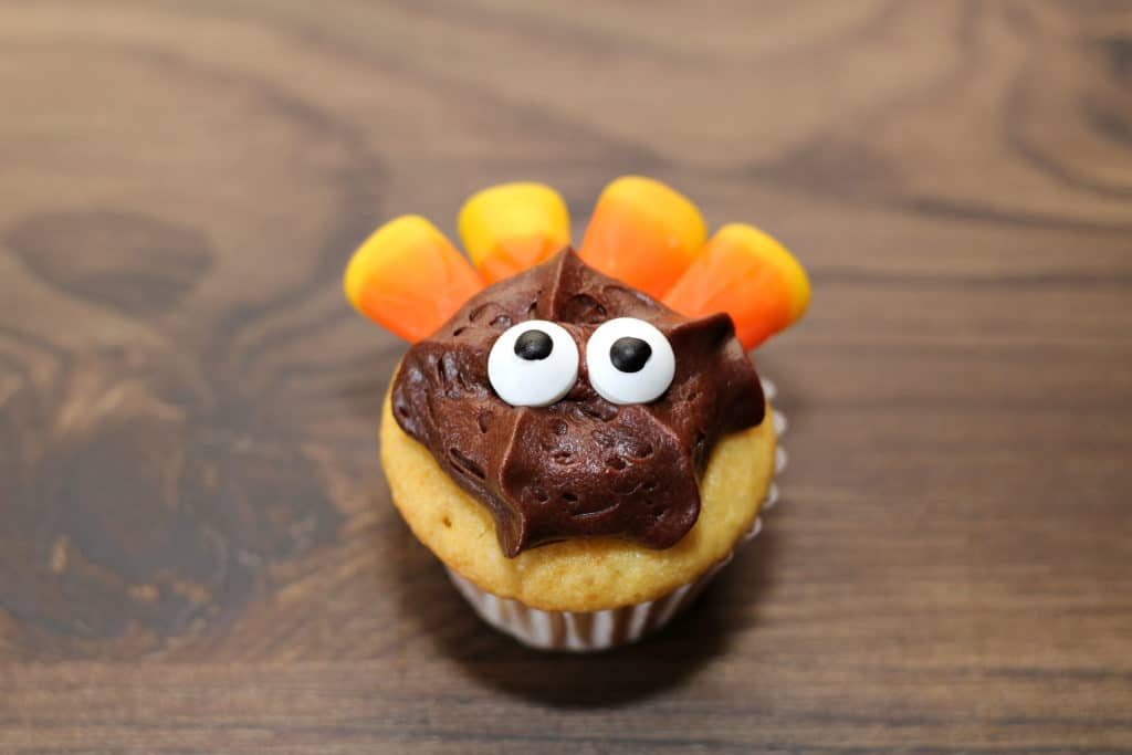 candy corn and candy eyes on turkey cupcake