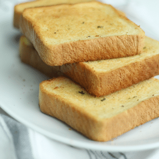 texas toast on a white plate