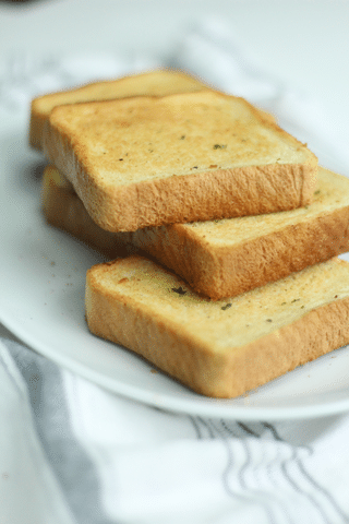 texas toast garlic bread on white plate