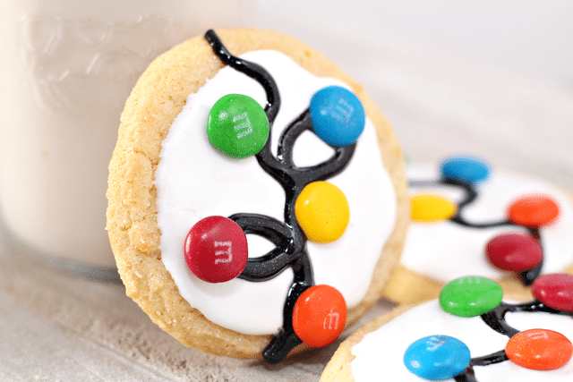 sugar cookies with white icing, gel icing and m&ms