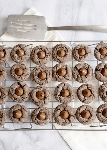 chocolate cake mix cookies with hershey kiss on cooling rack