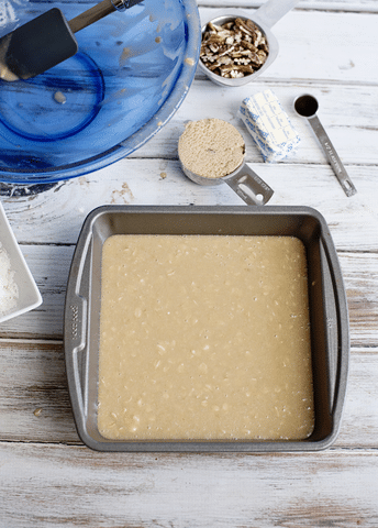 cake mix in baking pan, blue bowl, butter, vanilla, brown sugar