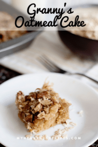 oatmeal cake with pecan frosting on white plate