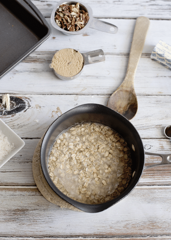 oatmeal, brown sugar, wooden spoon