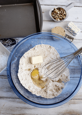 cake mixture, egg, butter, brown sugar, oatmeal, baking pan, blue bowl