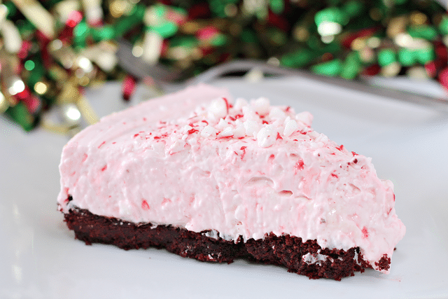 peppermint cheesecake with oreo crust and christmas background