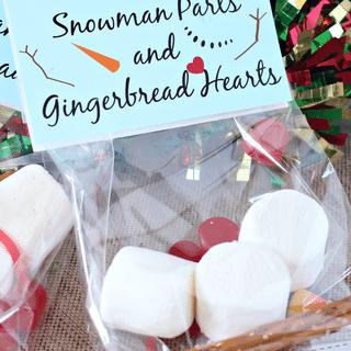 marshmallows, pretzel sticks, candy corn, red dots, snowman parts label