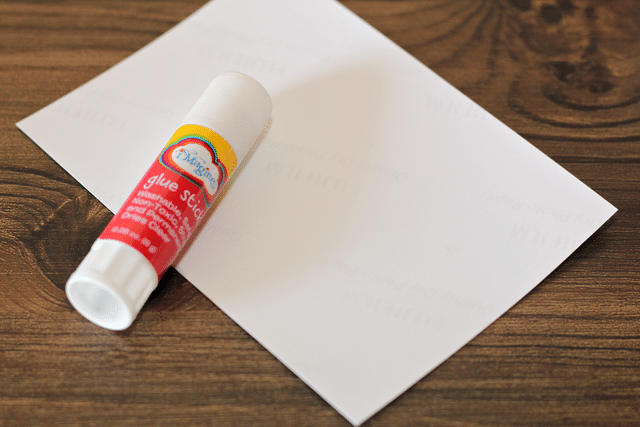 white envelope and glue stick