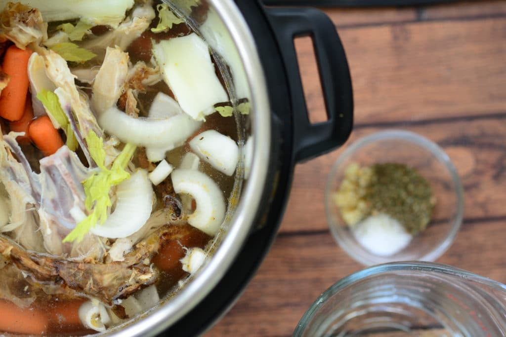 Almost all of the ingredients are in the Instant Pot for Instant Pot Chicken Broth