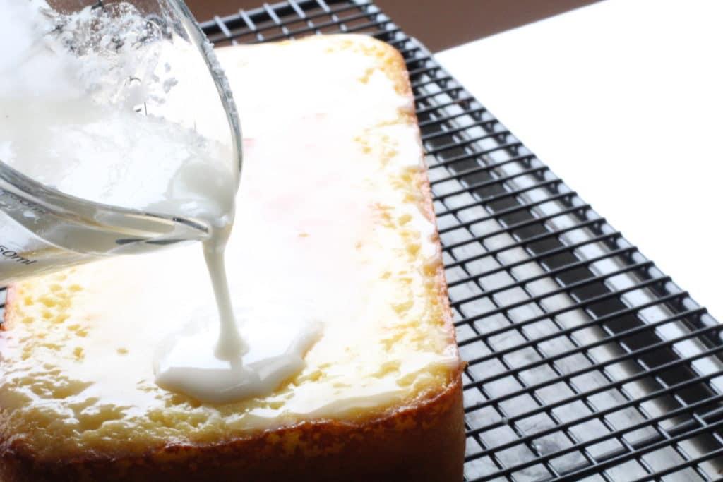 pouring glaze over starbucks lemon loaf recipe