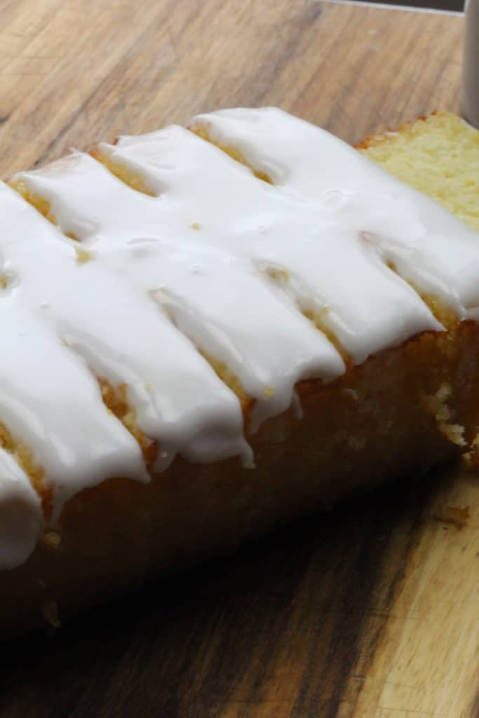 lemon loaf cut into slices with glaze on top