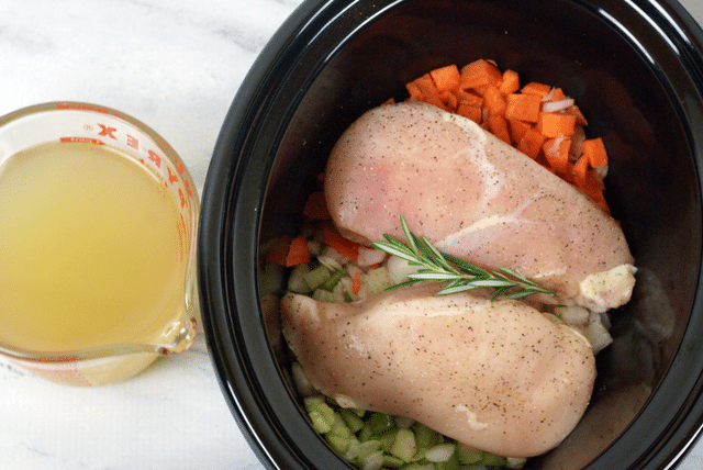 chicken broth, chopped carrots, rosemary, chopped celery, chicken breasts