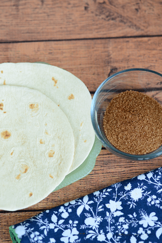 cinnamon sugar mixture in bowl and two tortillas