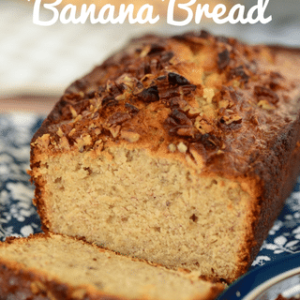 sliced cream cheese banana bread on blue plate with text