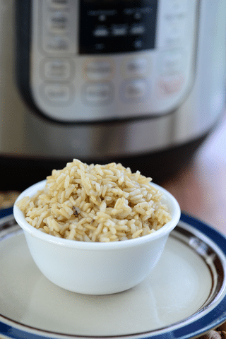 brown rice in white bowl in front of instant pot