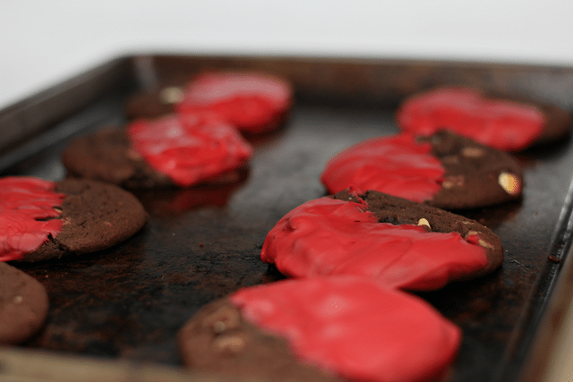chocolate cookies with red melted chocolate