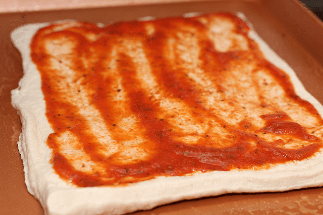 pizza crust with pizza sauce