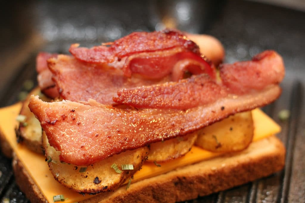 assembling grilled cheese with bacon