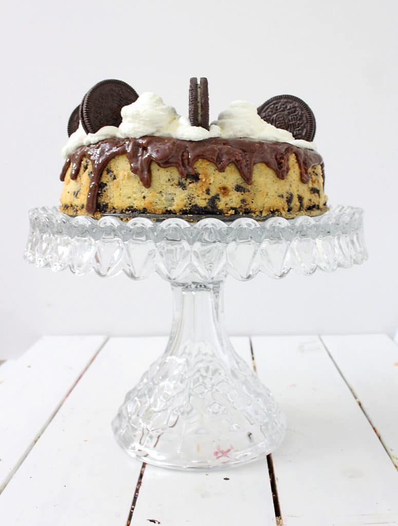 Oreo Cheesecake on a cake stand, side view