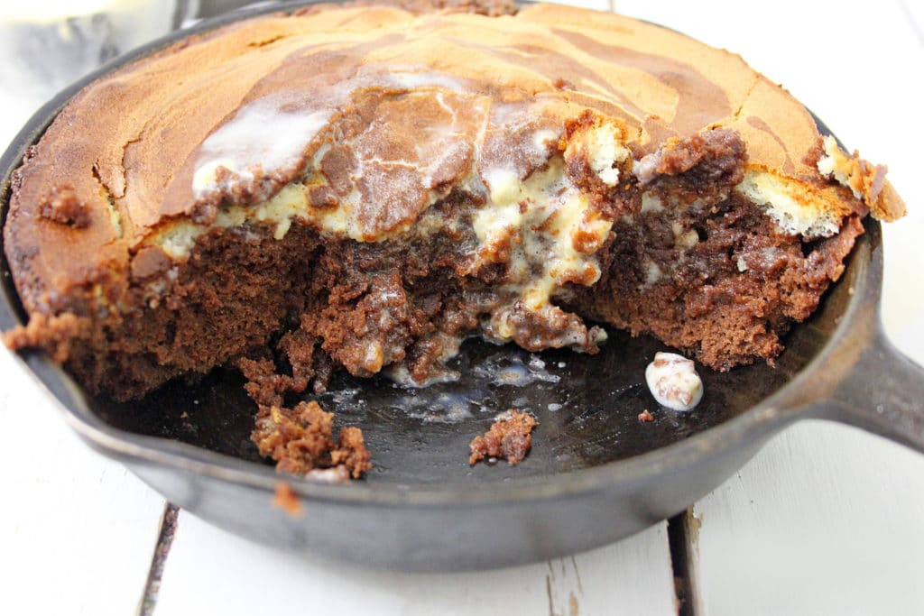 skillet brownie with half cut out
