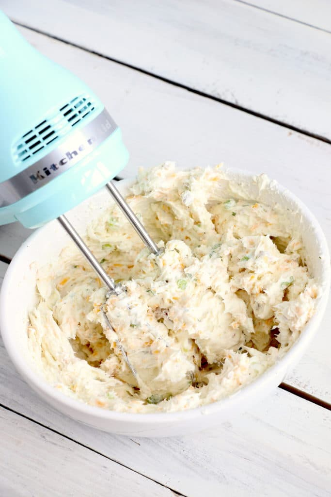 Mix together cheeseball ingredients with a hand mixer